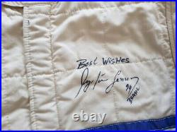 OMP race suit hand signed by Ayrton Senna