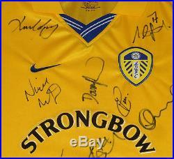 Professionally Framed Leeds United 2000-01 Champions League Squad Signed Shirt