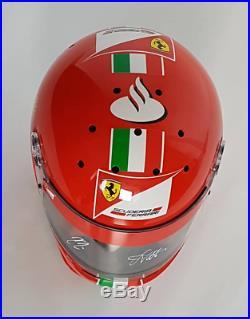 VERY RARE! Scuderia Ferrari F1 pit crew Bell helmet, signed by Vettel and Kimi
